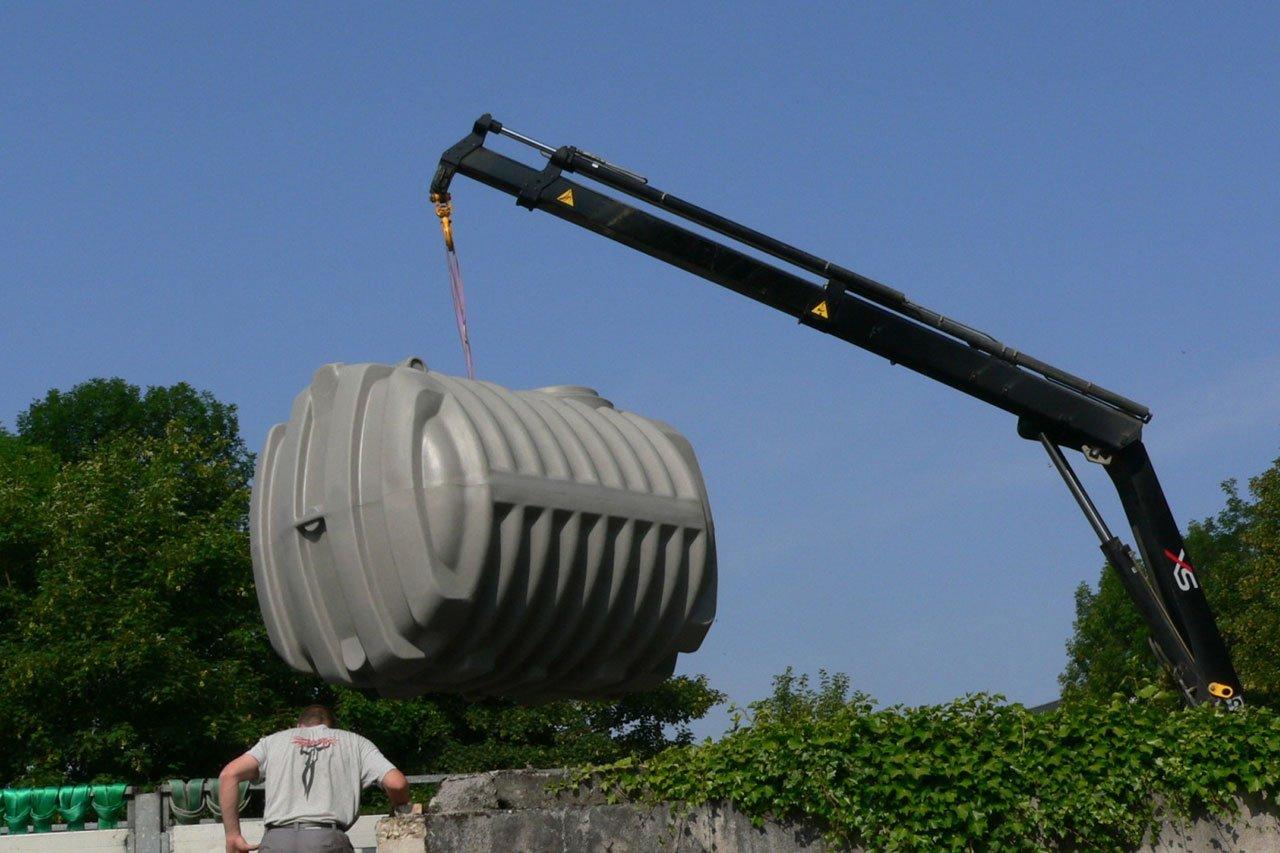 Récupération de l'eau de pluie des maisons containers